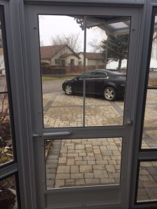 Looking through screen door out onto driveway